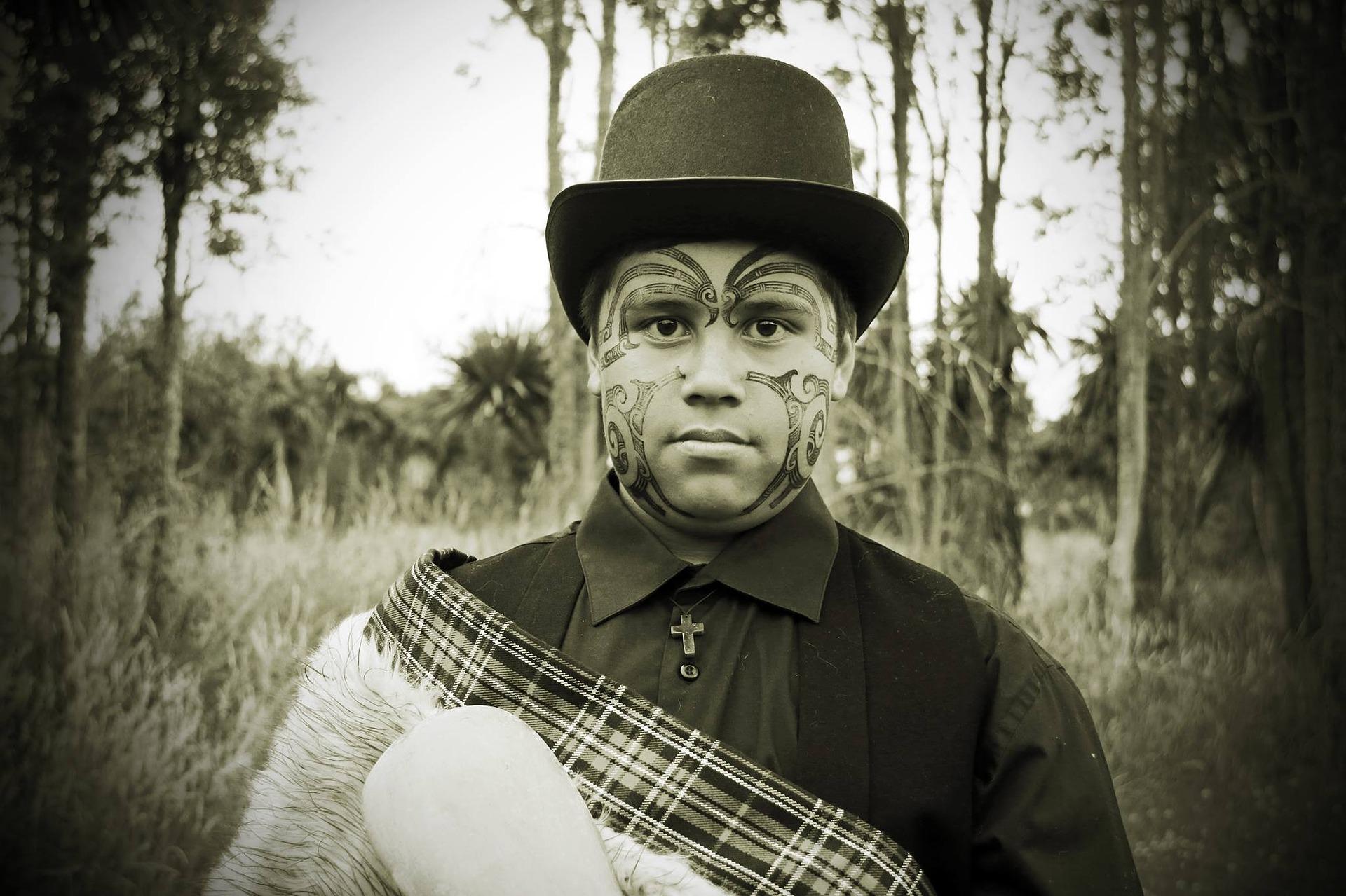 A tattooed male Maori face