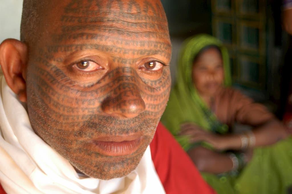 An Asian man with primitive facial tattoos