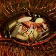 A close up of a horrified eye