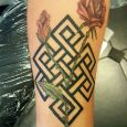 Two roses in color with a geometric pattern