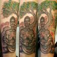 A tattoo of a skinny Buddha meditating