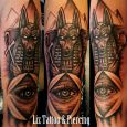 A tattoo with an egyptian theme